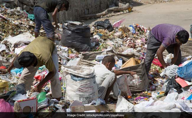 slum people cleaning roads